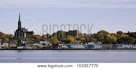 Wide view the city of Chatham, NB, looking across the Miramichi River at the city of Chatham on a bright colorful sunny day in October.