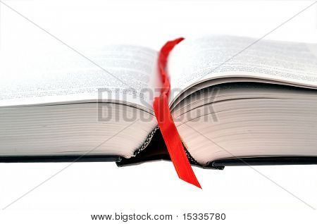 opened book with red bookmark on white