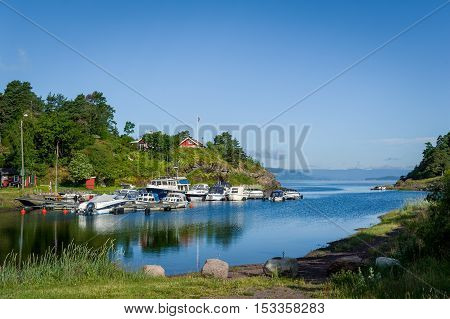 Typical nordic bay with recreational boats moored. Falkensten, Norway.