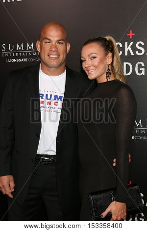 LOS ANGELES - OCT 24:  Tito Ortiz, Amber Nicole Miller at the