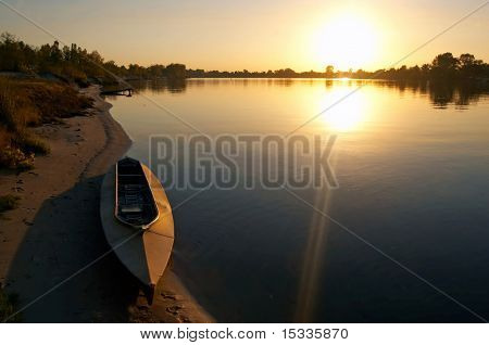sunset at riverside with boat