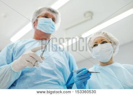 surgeons operate on a patient in the background Surgical Lamp