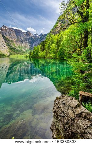 Stunning Obersee lake with reflection in Alps Germany
