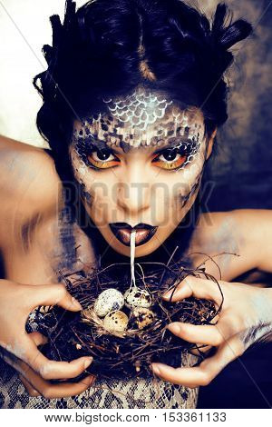 fashion portrait of pretty young woman with creative make up like a snake, look for celebration halloween