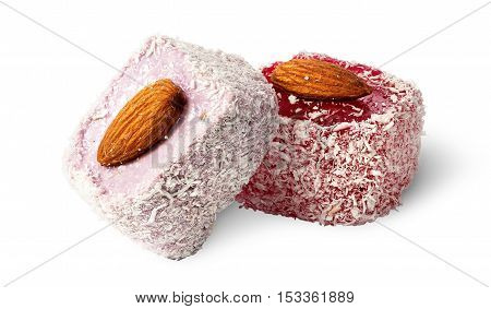 Two pieces of Turkish Delight with almonds isolated on white background