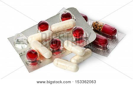Heap of pills and capsules in package isolated on white background