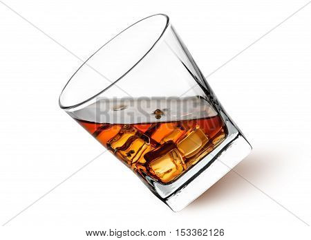 Whiskey with ice in a tilted glass isolated on white background