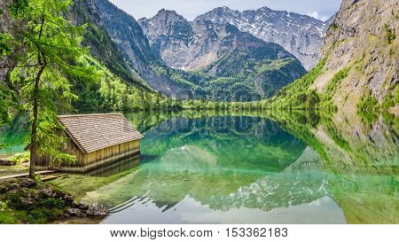 Stunning View Of Little Cottage On The Lake Obersee In Alps