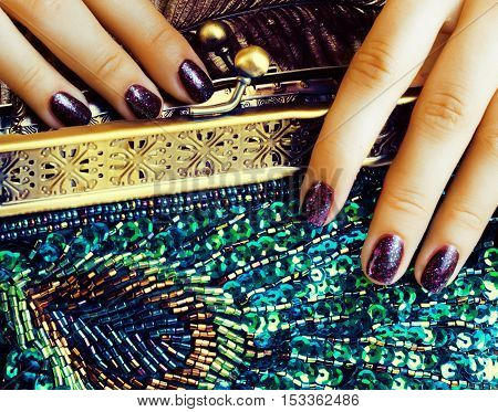 beauty woman fingers with manicure holding luxury bag
