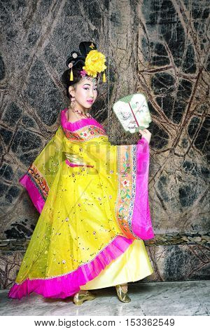 Fashion Geisha In Yellow Tradition Chinese Dress Dance With Fan