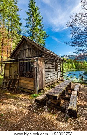 Old Forest Wooden Hut In The Alps At The Lake