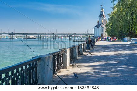 DNEPR UKRAINE - SEPTEMBER 10 2016:Dnepr river embankment with fishermen and their rods during City Day local activity in Dnepr, Ukraine at September 10, 2016