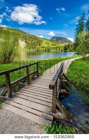 Beautiful Small Bridge On The Lake In The Alps