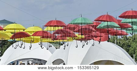 Dangling versicolor color parasols on Sofievska square at the time of Celebrating the Day of Kyiv 05-31-2015