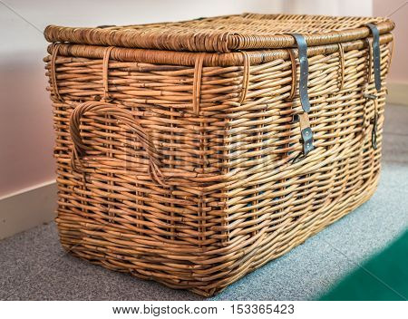 Wicker basket on the background in the room