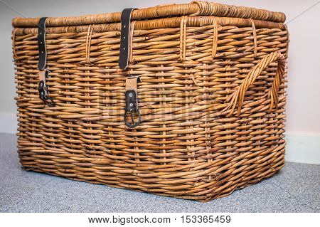 Wicker basket on the light background in the room
