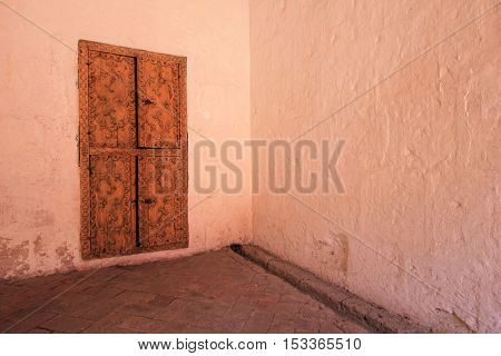 Door inside the famous monastery of Saint Catherine, Santa Catalina, in Arequipa, Peru. It belongs to the Dominican Second Order. It's built predominantly in the Mudejar style in 1579.