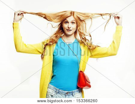 young pretty red head woman with long curly hair looking confused thinking, holding ringlets isolated on white background, lifestyle people concept close up