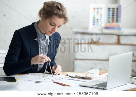 Female Designer Using Drawing Compass