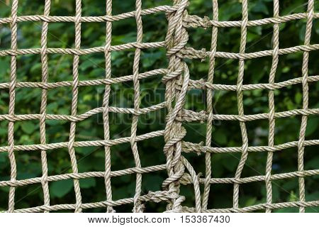 Net braided from ropes. Background texture.