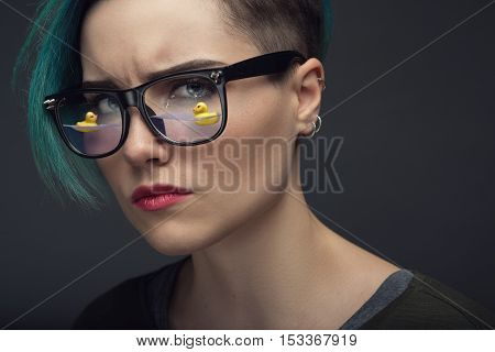 Creative artistic portrait of crying young woman. Eyes full of tears concept