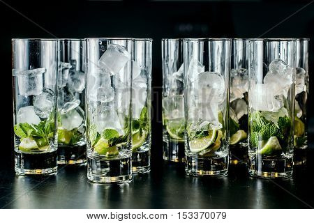 Mint ice and lime in the glasses.. Dark Rustic Style