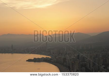 View of Benidorm city and beach at the sunset from hill.