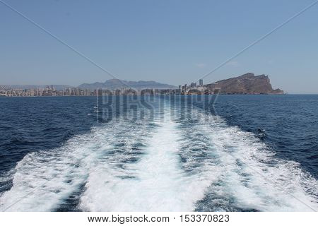 View to the Benidorm city, island and beach from the Mediterranean sea.