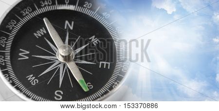Compass in a blue sky