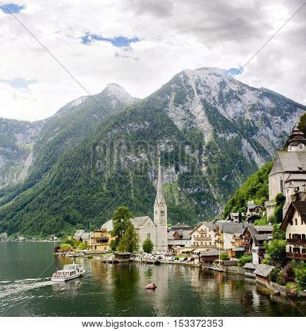 Hallstatt beautiful village in Austria, boat approaching