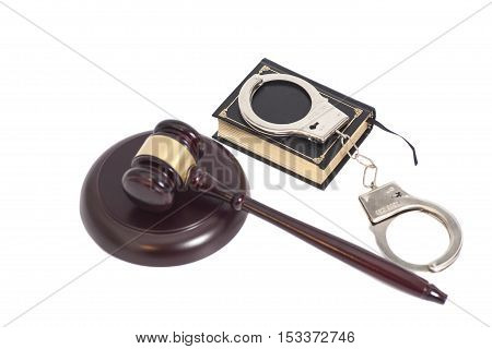 Judge gavelHandcuffs and book on law isolated on white background