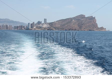 View to the Benidorm city, beach and island from the Mediterranean sea.