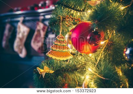 Beautiful Decorated Christmas Tree With Baubles And Garland Decorated Gingerbread, On The New-year B