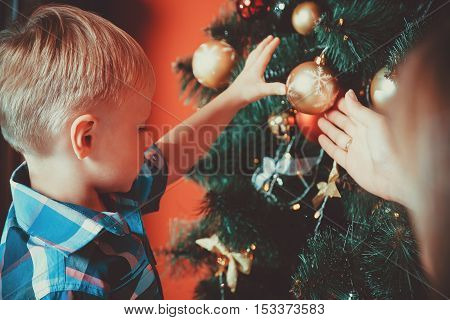 Beautiful Portrait Of Happy Mother And Son Decorating Christmas Tree In New Year Room. The Idea For