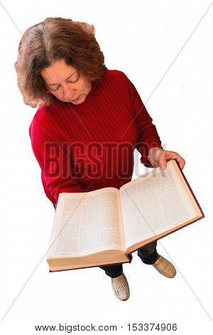 Woman in red sweater holding a large open book in his hands. A woman stands on the white background isolated