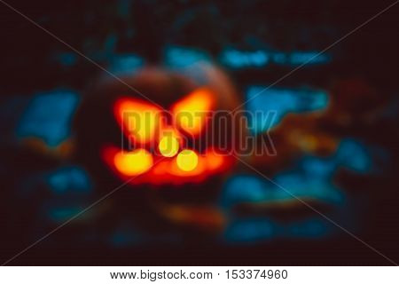Halloween Night Blurred Background With Pumpkin. Soft Focus. Shallow Dof