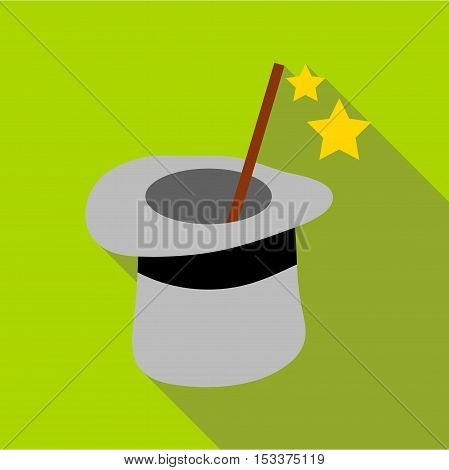 Magic hat and wand icon. Flat illustration of magic hat and wand vector icon for web isolated on green background