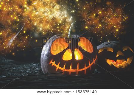 Halloween pumpkin at wood background. October holiday. Pumpkins family