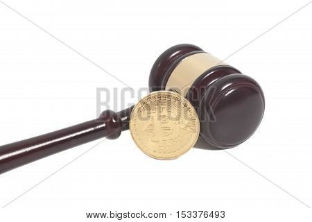 Wooden judge gavel with Golden Bitcoin coin (digital virtual money) isolated on white
