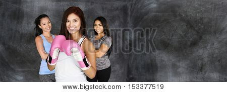 Young female boxer with gloves working out