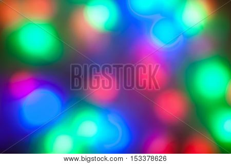 colorful garlands of lights out of focus. New Year Christmas background