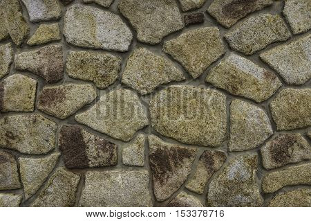 The wall compiled from large colored stones