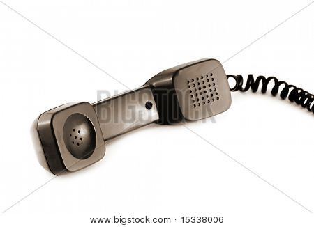 Old style telephone receiver isolated on a white background