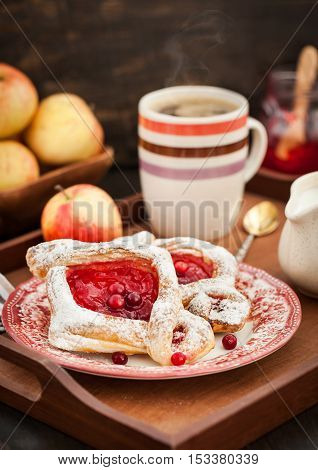 Delicious Berry Puff Pastry With Powdered Sugar And Coffee