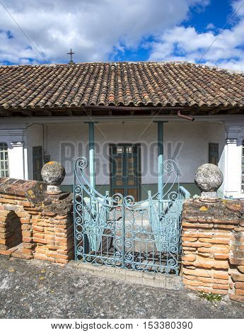 Front gate of an old colonial house in Cuenca Ecuador