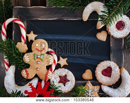 Christmas cookies on chalk board background with copy space top view
