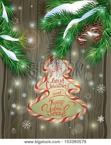 Winter holiday design. Old Wooden background with candy frame fir tree branches and snow. Merry Christmas and Happy New Year calligraphy.