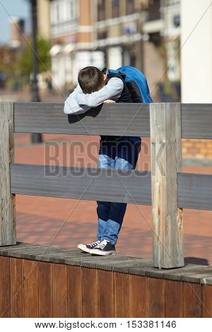 schoolboy crying on the street negative emotion