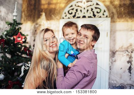 happy family, parents and son celebrating Christmas and New Year