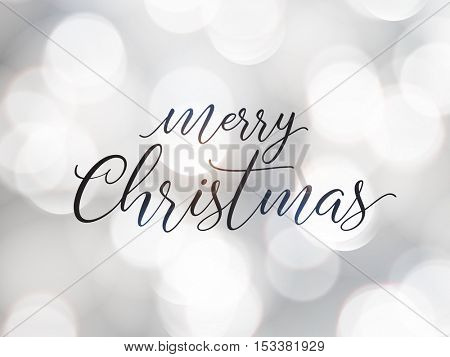 Merry Christmas greeting card. Typographic vector design, beautiful white bokeh background.